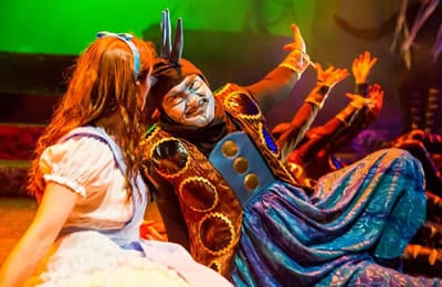 Kathy Gordon as Alice, Vato Tsikurishvili as Caterpillar in Alice in Wonderland by Synetic Theater. (Photo: Johnny Shryock)