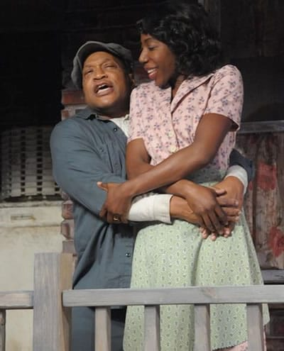 Alan Bomar Jones as Troy and Joy Jones as Rose in Fences at Everyman Theatre (Photo: Stan Barouh)