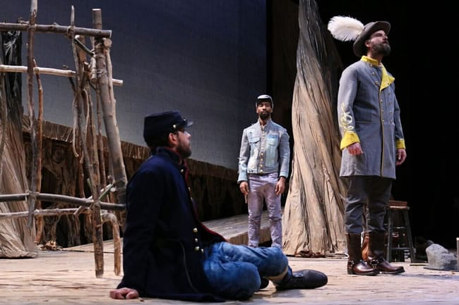 Michael Kevin Darnall (as Smith), JaBen Early (as Hero), and Tim Getman (as Colonel) in Round House Theatre's production of Father Comes Home From The Wars (Parts 1, 2 & 3) by Suzan-Lori Parks. (Photo: Cheyenne Michaels)