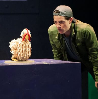 Chris Dinolfo with the golden chicken in JACK and Phil, Slayers of Giants-INC at Imagination Stage (Photo: Margot Schulman)