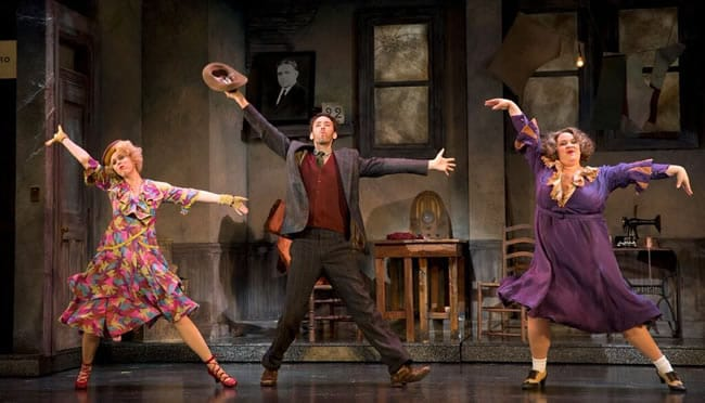(l-r) Werner as Lily, Garrett Deagon as Rooster Hannigan and Lynn Andrews as Miss Hannigan in Annie at the National Theatre (Photo: © Joan Marcus)