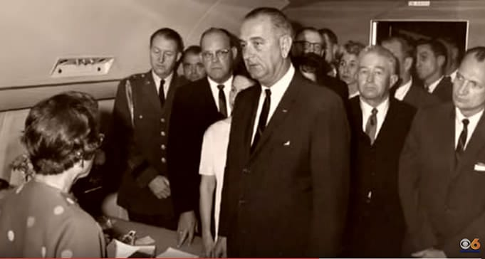 President Lyndon Baines Johnson taking the oath of office, November 22, 1963. Sid Davis, far right, leaning in (Photo source: WTVR CBS 6)