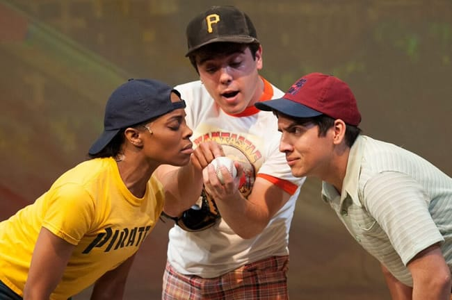 Sam shows off his magic 3,000th hit baseball to his best friends, Charlie and Peter. (L-R: Eben K Logan as Sam, David Landstrom as Sam, , Philip da Costa)Looking for Roberto Clemente at Imagination Stage (Photo: Margot Schulman)