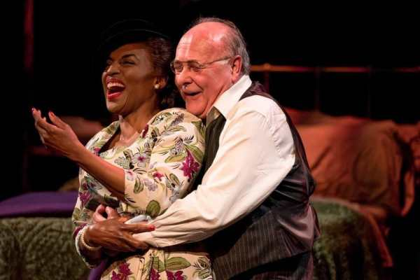 """Dawn Ursula as """"The Woman"""" with Wil Love as Willy in Death of a Salesman at Everyman Theatre (Photo: ClintonBPhotography)"""