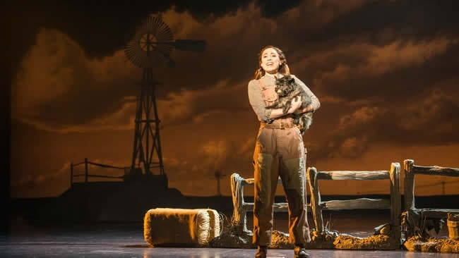 Sarah Lasko as Dorothy and Nigel as Toto in Over The Rainbow at the National Theatre (Photo: Daniel A. Swalec)