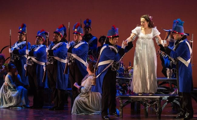 Rachele Gilmore as Ninetta and members of the ensemble in The Glimmerglass Festival's production of The Thieving Magpie (Photo: Karli Cadel/The Glimmerglass Festival)