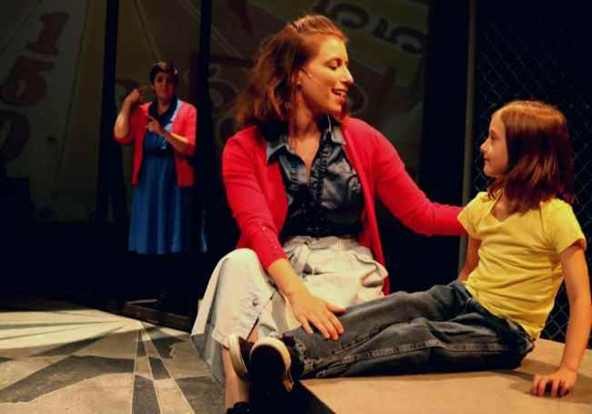 Michelle Mary Schaefer (Ensemble), Autumn Seavey Hicks (Mrs. Walker) and Kira Mitchiner (Tommy (age 4) in The Who's Tommy from Open Circle Theatre (Photo: Dilder Photography)