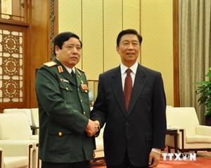 Phó Chủ tịch Trung Quốc Lý Nguyên Triều và Bộ trưởng Quốc phòng Phùng Quang Thanh. (Nguồn: TTXVN)