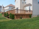 home improvement rear deck with landscaping