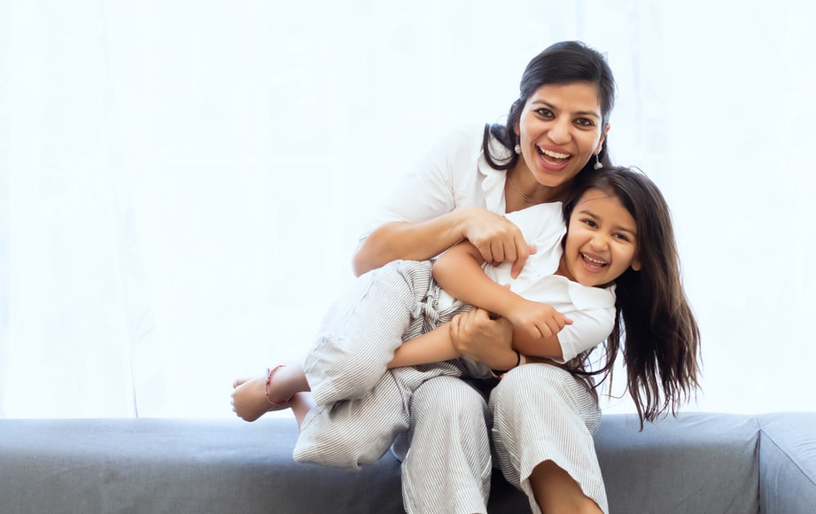 mother with joint custody holding daughter