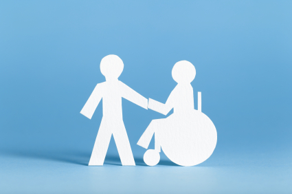 Paper cut outs of two figures holding hands, one of them is in a wheelchair