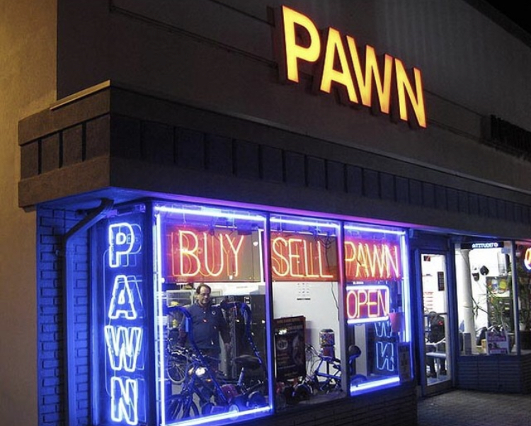 Pawn Store shown at night with neon lights