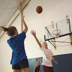 Photo of kids playing basketball