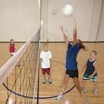Photo of children playing volleyball in the gym