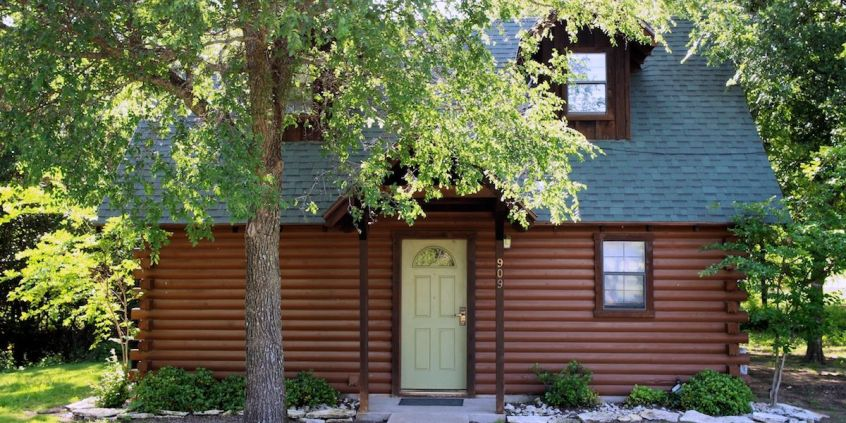Photo of a one of the White Bluff rustic cabins