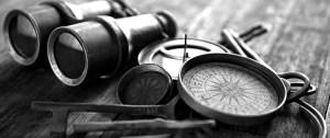 Antique compasses, keys, and binoculars
