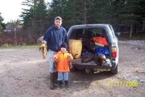 Good day of trapping, father & son