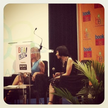 Amy Tan interviewed in front of audience at the Downtown Stage.