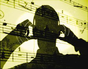 man-listening-to-music-on-headphones-jason-reedryan-mcvay