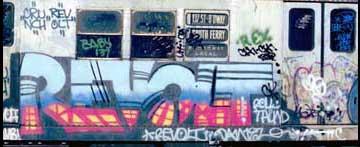 Revolt graffiti art on New York City Subway Car.