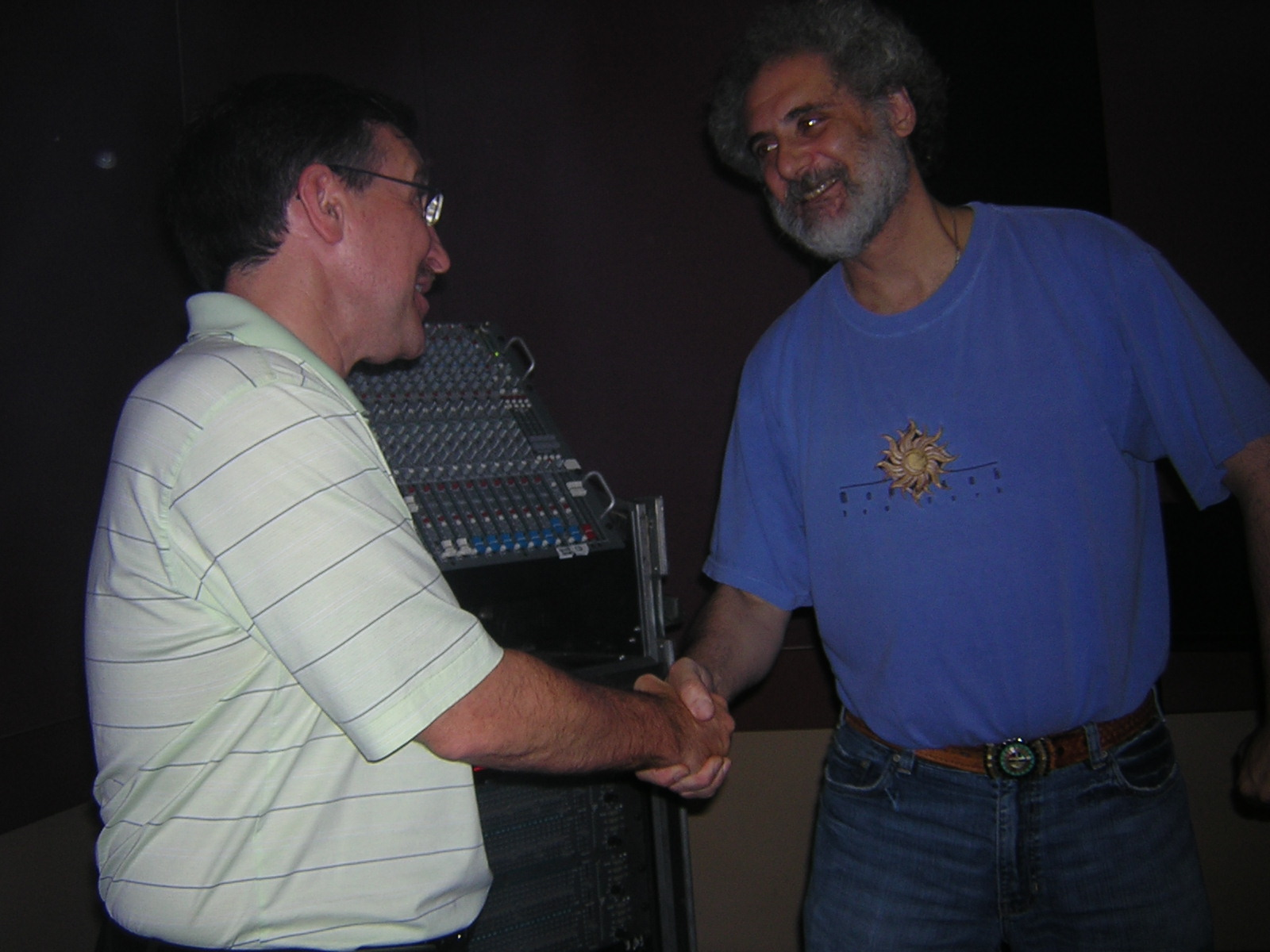 Maurice and Rich shaking hands after 20 years
