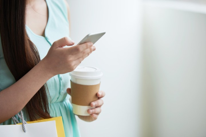 woman answering a text message