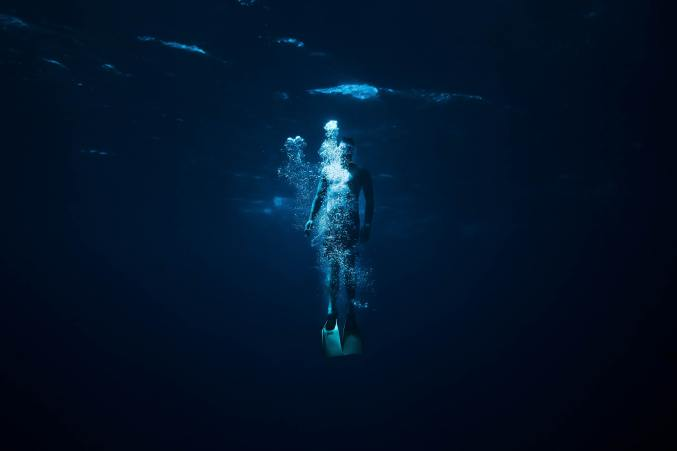 A person swimming underwater