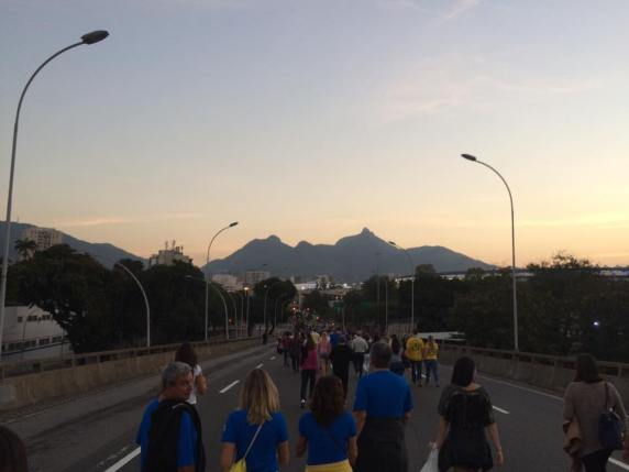 The road leading to the Olympic Stadium, full of fans walking down the overpass