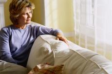 Photograph of a woman sitting on a couch
