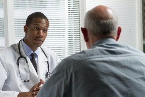 Black Doctor with Male Patient
