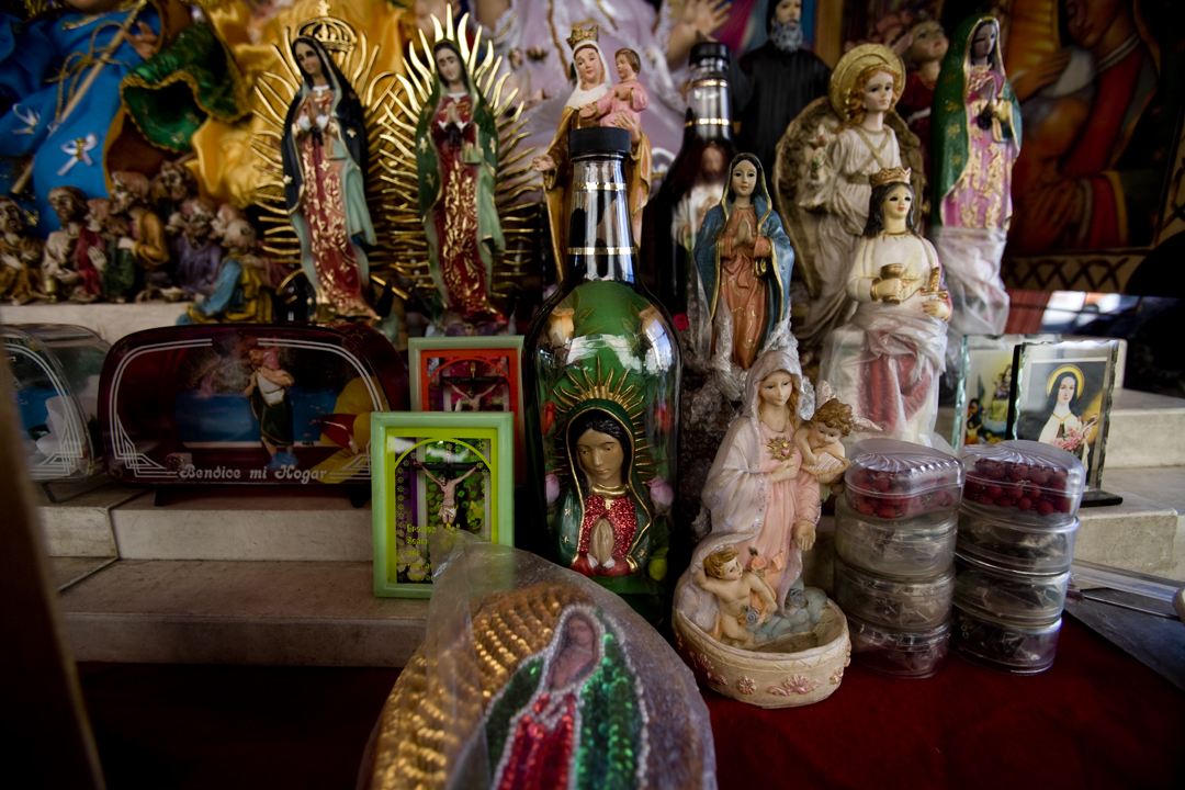 A virgin in a bottle sits for sale outside a church in Tijuana, Mexico.