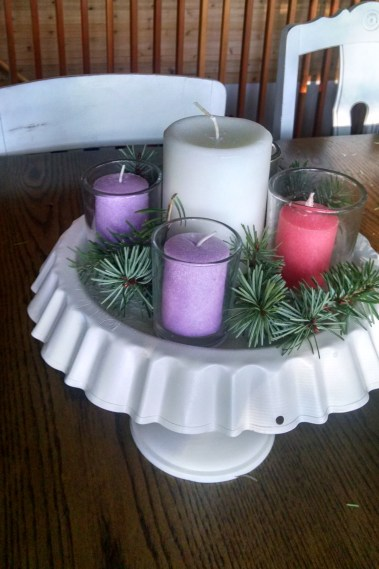 This is the advent wreath we have used the past two years: cake stand, votive candles, large white candle, greenery collected from the yard.