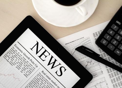bigstock-Apple-Ipad-With-News-On-Desk-24449495
