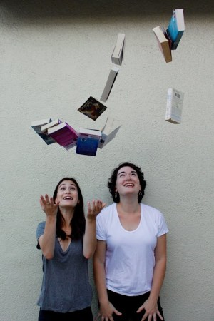 Leah and Beah with flying books