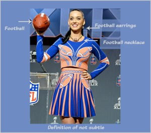Katy Perry at her pre Super Bowl press conference: the definition of not subtle. DearKidLoveMom.com