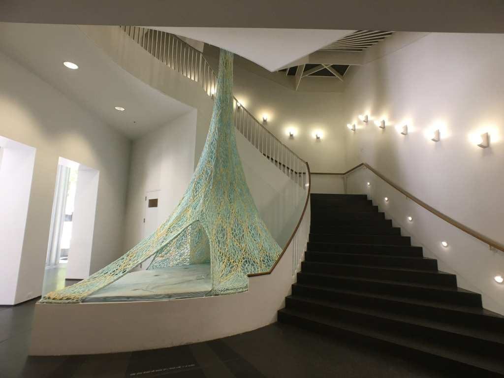 staircase leading to the basement level of the museum of contemporary art