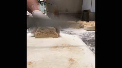 slicing the sticky bun recipe