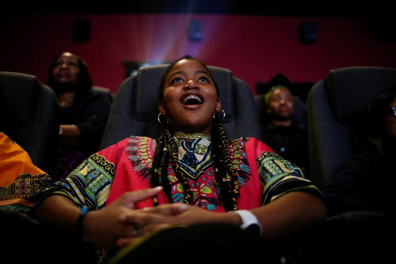 """Ron Clark Academy 6th grader De Ja Little, 12, joins classmates in watching the film """"Black Panther"""" at Atlantic Station theaters in Atlanta"""