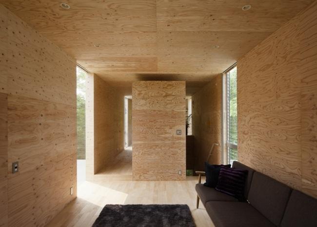 Holzhaus im Wald schwebt in der Luft  Entwurf von UID