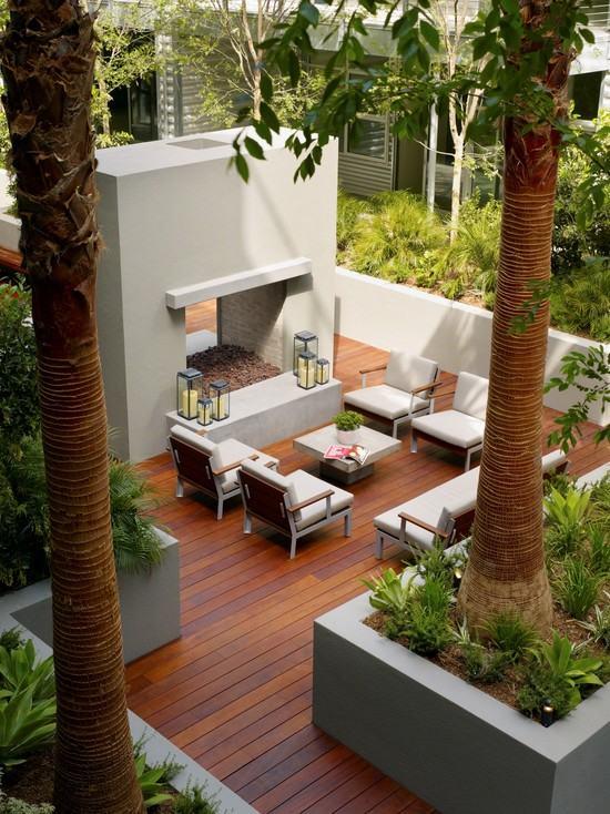 Terrassen Ideen Garten Dielenboden Lounge Bereich Kamin Palmen