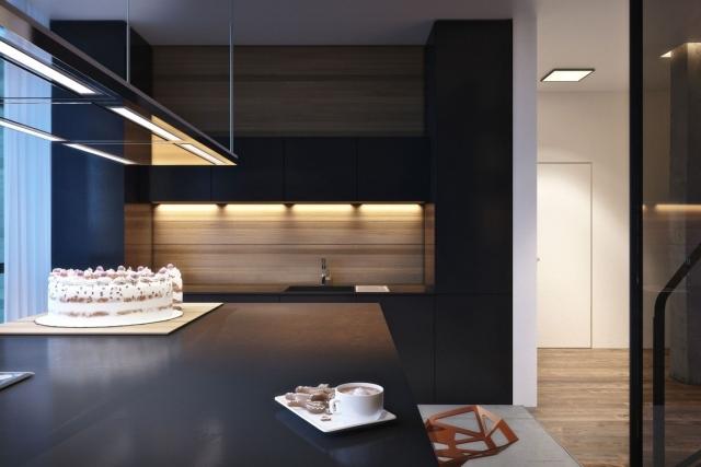Eine moderne Wohnung wo Beton Holz und Metall gemtlich wirken