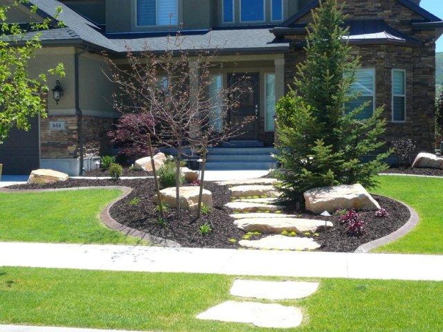 Vorgarten Gestaltung Kies Bruchsteine Baume Pflanzen