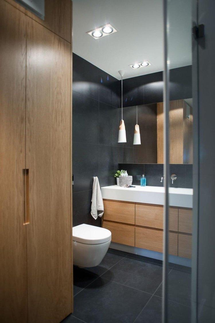 Farbe Grau und Holz wirken wohnlich  moderne Wohnung in Polen