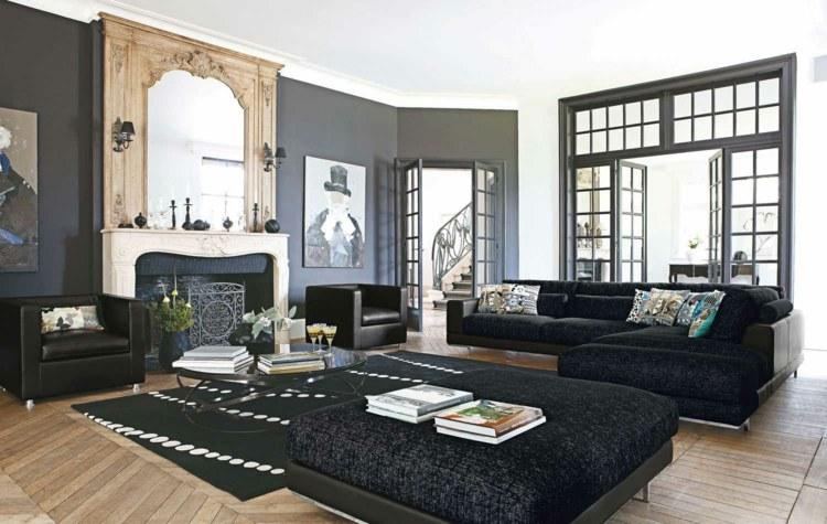 Wohnzimmer Blaue Wandfarbe Dunkle Leder Sessel Und Couch Nesstisch ...