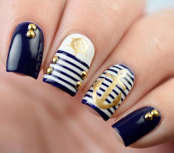nail polish in dark blue and white golden accents
