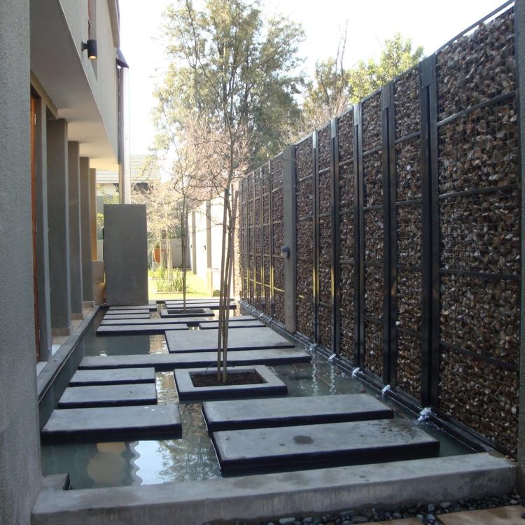 Intgrer le mur gabion comme lment dcoratif dans le jardin