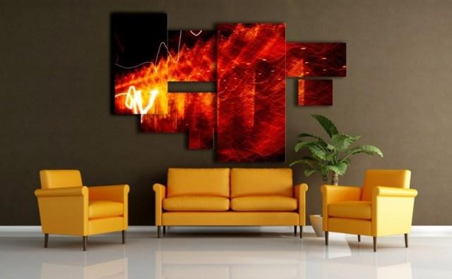 decoration-salon-tableaux-nuances-rouge-orange-canapé-fauteuils-jaunes décoration de salon