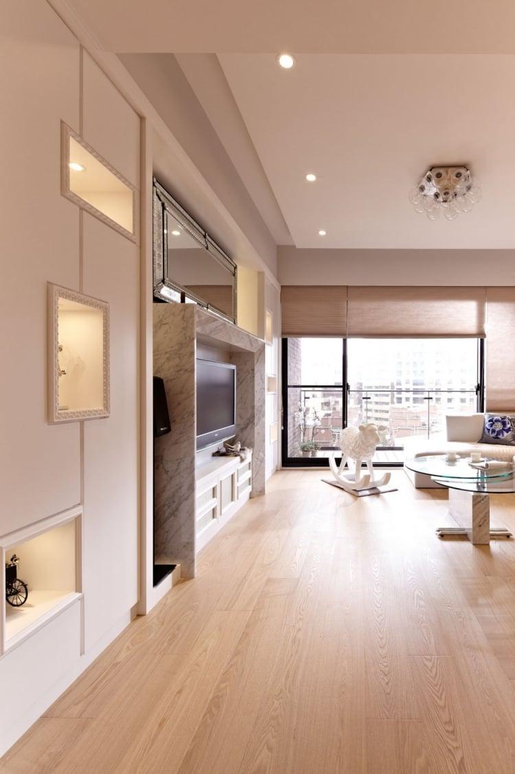 Meubles blancs et bois blond dans un appartement moderne