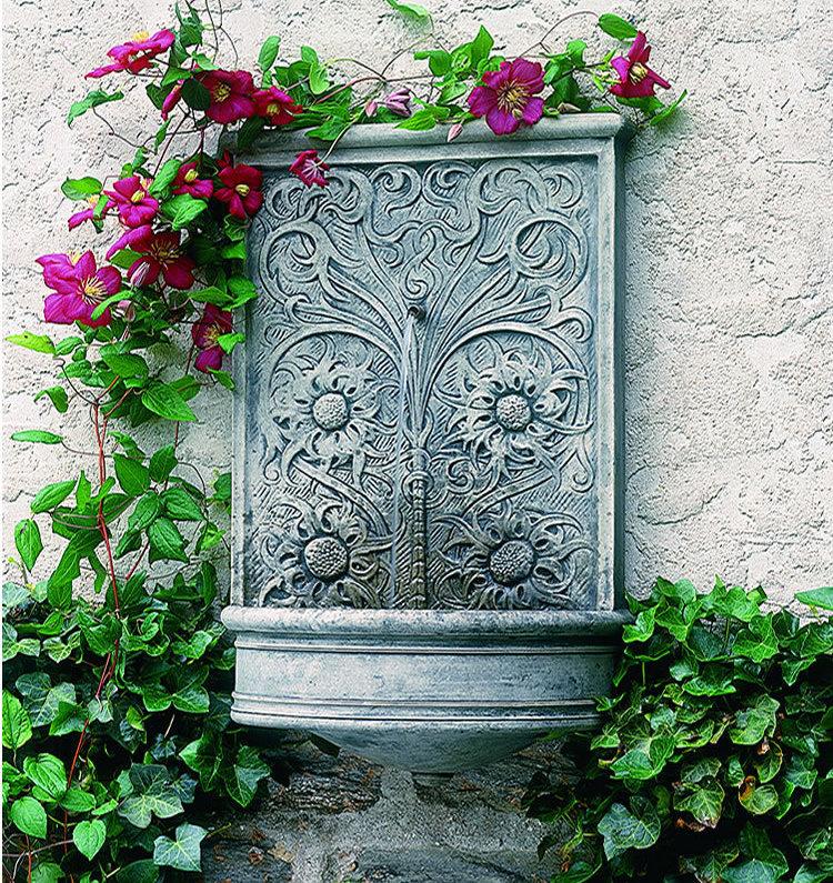 installer une fontaine murale de jardin
