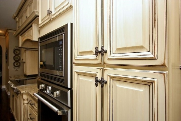 Kitchen cabinets with antiquing glaze in classic kitchen